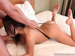 Hot Brunette Shoves Feet in Lover's Mouth and Give a Footjob
