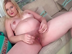 Young Curvy pregnant blond showing her hairy pussy