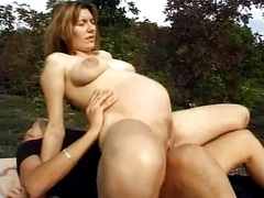 German pregnant bitch fucks outdoor