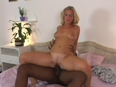 Euro Blonde loves riding black dick